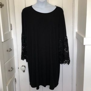 Plus size black dress with crochet sleeves